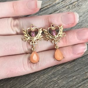 Gold plated dangle earrings with hearts and wings